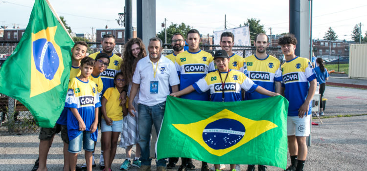 Team Brazil poses with flags